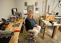 NWA Media/DAVID GOTTSCHALK - 7/3/14 - Stacie Florer Thursday July 3, 2014 in her favorite personal space, her art studio in the basement area of the Fayetteville Underground in Fayetteville.