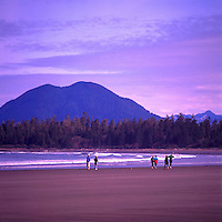 People hiking and jogging on Chesterman Beach near Pacific Rim National Park Reserve, on West Coast of Vancouver Island, BC, British Columbia, Canada