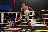 Derrick Osaze (grey shorts) defeats Tey Lynn Jones during Ultimate Boxxer III at Indigo at the O2 London on 10th May 2019