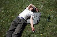 A man sleeps on top of a hill on the Qinghai-Tibetan Plateau, Qinghai Province. China. 2010