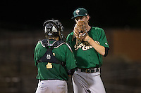 Savannah Sand Gnats catcher Tomas Nido (7) has a chat on the mound with relief pitcher Jimmy Duff (25) during the game against the Hickory Crawdads at L.P. Frans Stadium on June 15, 2015 in Hickory, North Carolina.  The Crawdads defeated the Sand Gnats 4-1.  (Brian Westerholt/Four Seam Images)