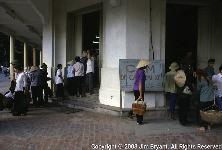 Long lines must be endured in order to purchase tobacco, sugar and salt from one of Hanoi's department stores in Hanoi, North Vietnam.  (Jim Bryant Photo...