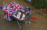 A wheel barrow full of Royal face masks and flags  during the wedding of Prince William and Kate Middleton in London..Picture: Maurice McDonald/Universal News And Sport (Europe).29 April 2011..