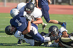 Torrance, CA 09/05/13 - Brandon Martin  (North #5), AJ Hezlep (Peninsula #12), Luke Megginson (Peninsula #78) and unidentified Peninsula player(s) in action during the Peninsula vs North Junior Varsity football game played at North High School in Torrance, California.