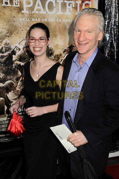 "GUEST & BILL MAHER.HBO's ""The Pacific"" Mini-Series Premiere held at Grauman's Chinese Theatre, Hollywood, California, USA..February 24th, 2010.half length suit jacket dress glasses black purple red sack bag purse .CAP/ADM/BP.©Byron Purvis/AdMedia/Capital Pictures."
