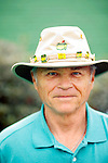 Gene Salet, of Augusta, Georgia, poses for a portrait outside of Gate 6 of the Augusta National Golf Club on the first tournament day of The Masters Golf Tournament in Augusta, Georgia April 8, 2010. The Phil Mickelson fan has been collecting pins for his hat since 1998.
