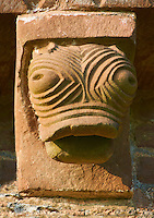 Norman Romanesque exterior corbel no 41 - sculpture of a grotesque stylised creatures head with bulging eyes. The Norman Romanesque Church of St Mary and St David, Kilpeck Herefordshire, England. Built around 1140