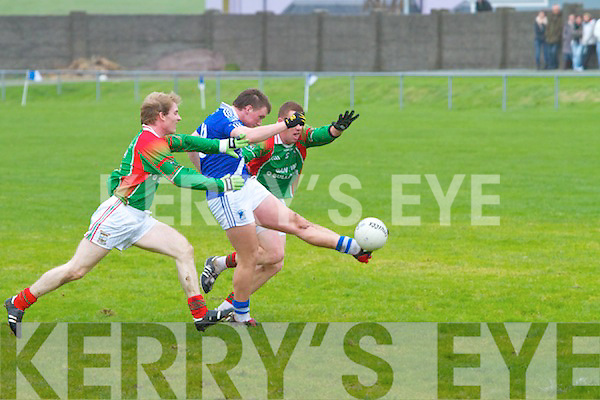 Denis Daly for St Mary's after overcoming several challenges gets enough space between St Michaels/Foilmores Colin Grandfield & Sean Fogarty to have a shot on goal but only finds the safe hands of keeper Roger Harty.