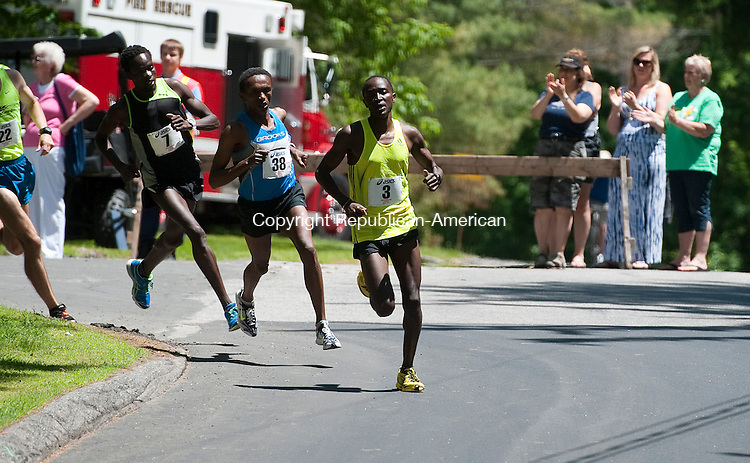 LITCHFIELD, CT-060814JS12--Eliud Ngetich (3), Allele Megersa (38) and Amos Ang (7) take a corner during the 38th running of the Litchfield Hills Road Race Sunday in Litchfield. <br /> Jim Shannon Republican-American