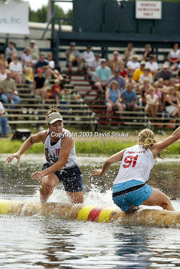 7/27/03 -Hayward, Wisconsin. Logrolling finals at the Lumberjack World Championships on Sunday. Tina Bosworth (18) beat Lizzie Hoeschler (91) in the finals. (Photo by David Stluka)