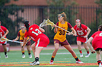 Los Angeles, CA 02/28/14 - Jamie Romano (Marist #13) and Alex Moore (USC #30) in action during the Marist Red Foxes vs University of Southern California Trojans NCAA Women's lacrosse game at Loker Track Stadium on the USC Campus.  Marist defeated USC 12-10.