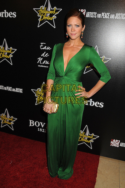 Brittany Snow.5th Annual Hollywood Domino Gala & Tournament held at the Sunset Tower Hotel, West Hollywood, California, USA..February 23rd, 2012.full length dress hand on hip low cut plunging neckline gold clutch bag.CAP/ADM/BP.©Byron Purvis/AdMedia/Capital Pictures.