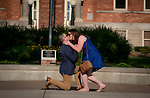 Ben Burich surprises girlfriend Megan Schulz with a marriage proposal at St. Norbert College in De Pere, Wis., on July 8, 2017. The couple met at the college just prior to graduating in 2014.