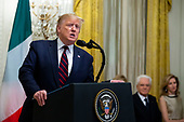 US President Donald J. Trump (L) delivers remarks, as President of Italy Sergio Mattarella (2-R) and his daughter and Italy's First Lady Laura Mattarella (R) look on; at a reception in the East Room of the White House in Washington, DC, USA, 16 October 2019. US President Donald J. Trump hosted the President of Italy Sergio Mattarella and his daughter and Italy's First Lady Laura Mattarella at a reception held in honor of the Italian Republic.<br /> Credit: Michael Reynolds / CNP
