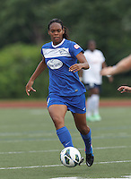 Boston Breakers defender Kia McNeill (14) brings the ball forward.  In a National Women's Soccer League Elite (NWSL) match, Sky Blue FC (white) defeated the Boston Breakers (blue), 3-2, at Dilboy Stadium on June 16, 2013.