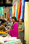 A woman being fitted in a Saree at Rokko's Fabrics in Vancouver, B.C.