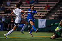Seattle, WA - Sunday, September 11 2016: Seattle Reign FC midfielder Rumi Utsugi (20) takes a shot on goal during a regular season National Women's Soccer League (NWSL) match between the Seattle Reign FC and the Washington Spirit at Memorial Stadium. Seattle won 2-0.