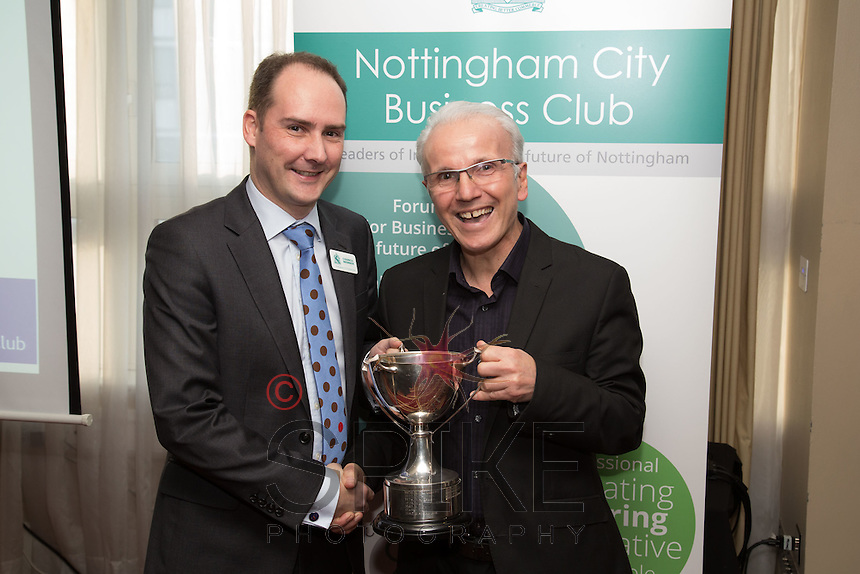 James Simmonds of UHY Hacker Young collects the NCBC Golf Trophy from Frank Ciaurro of Cema