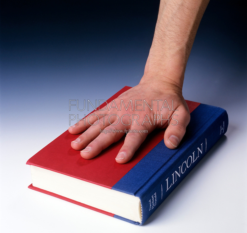 HAND PUSHES DOWN ON BOOK<br />