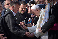 Pope Francis kisses the Falkland (Malvinas) unknown soldier's marble stele during his weekly general audience on the Saint Peters' square on October 30, 2019 at the Vatican.