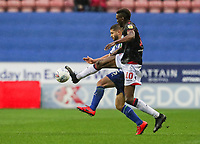Bolton Wanderers' Sammy Ameobi competing with Wigan Athletic's Sam Morsy <br /> <br /> Photographer Andrew Kearns/CameraSport<br /> <br /> The EFL Sky Bet Championship - Wigan Athletic v Bolton Wanderers - Saturday 16th March 2019 - DW Stadium - Wigan<br /> <br /> World Copyright &copy; 2019 CameraSport. All rights reserved. 43 Linden Ave. Countesthorpe. Leicester. England. LE8 5PG - Tel: +44 (0) 116 277 4147 - admin@camerasport.com - www.camerasport.com