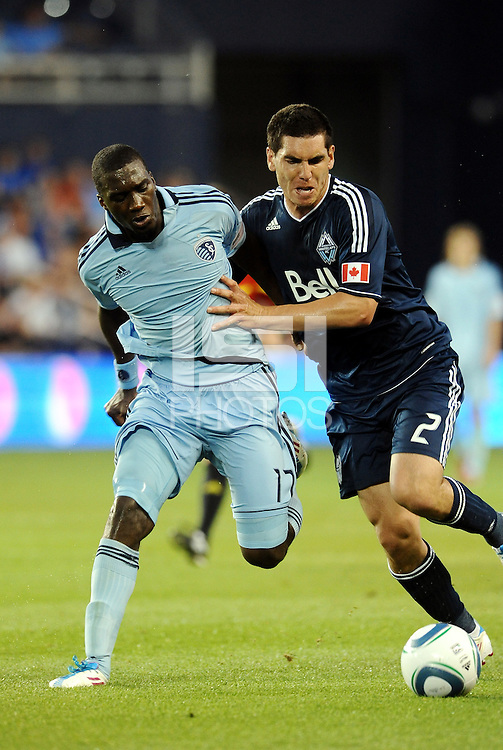 Vancouver Whitecaps defender (2) Michael Boxall holds off Sporting KC forward C.J Sapong... Sporting KC defeated Vancouver Whitecaps 2-1 at LIVESTRONG Sporting Park, Kansas City, Kansas.