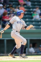 Right fielder Jordan Patterson (10) of the Asheville Tourists bats in a game against the Greenville Drive on Sunday, July 20, 2014, at Fluor Field at the West End in Greenville, South Carolina. Asheville won game one of a doubleheader, 3-1. (Tom Priddy/Four Seam Images)