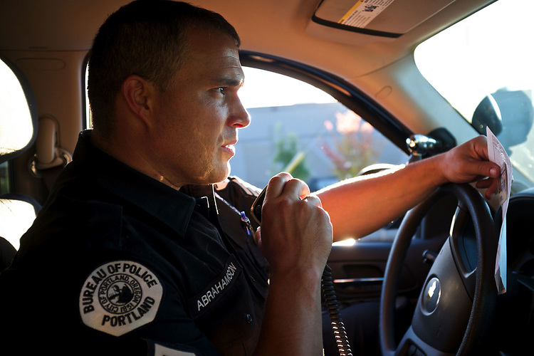 Sgt. David Abrahamson, a Bureau of Police officer with the traffic investigation unit, talks with dispatch about a license plate during a traffic stop in North Portland.<br /> Photo by Jaime Valdez
