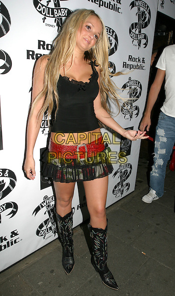 "JENNIFER ELLISON.Attends ""Christmas in July"" Fashion Show and Party, Pangaea, London,.13th July 2004..full length sheer black red rose flower print Wheels & Doll Baby skirt wide red belt black vest top cowboy boots funny hand gesture.Ref: AH.www.capitalpictures.com.sales@capitalpictures.com.©Capital Pictures."