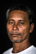 52 year old Tuna fisherman, Luciano Movera poses for a portrait at the Casa, the Tuna buying house in Puerto Princesa, Palawan in the Philippines. <br /> Photo: Sanjit Das/Panos for Greenpeace