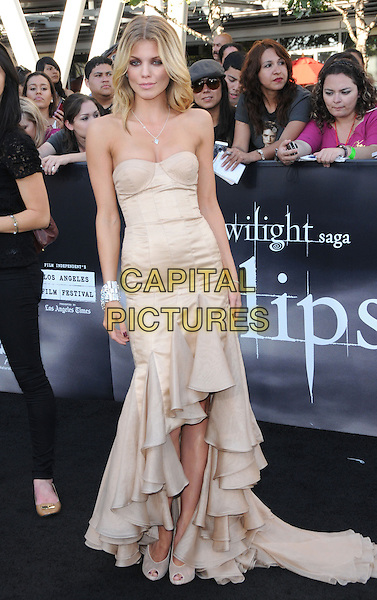 ANNALYNNE McCORD.The premiere of The Twilight Saga : Eclipse held at the Los Angeles Film Festival at Nokia Live in Los Angeles, California, USA..June 24th, 2010    .full length long maxi tiered ruffle dress ruffles peep toe cream shoes strapless beige  .CAP/RKE/DVS.©DVS/RockinExposures/Capital Pictures.