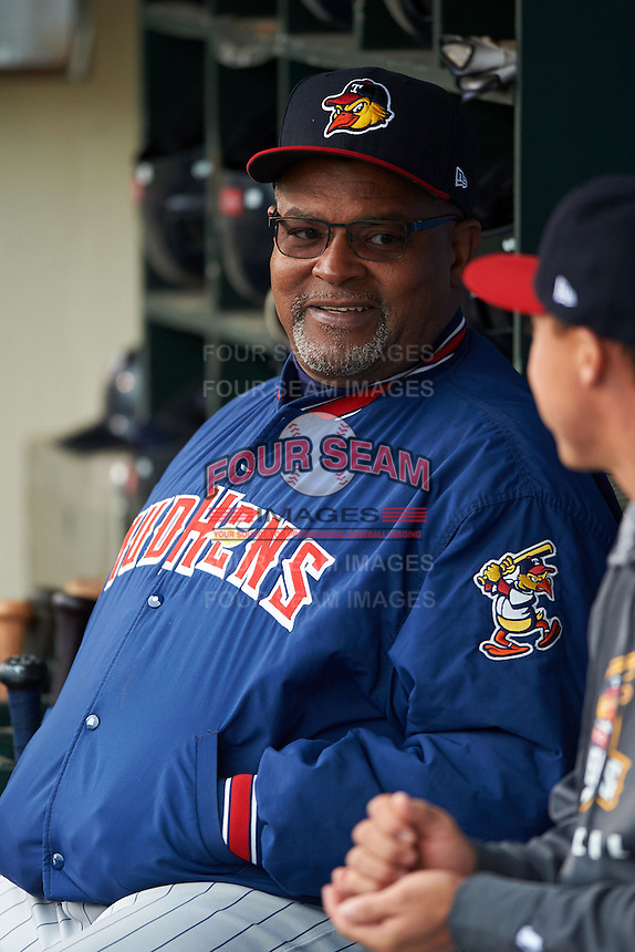 Toledo Mudhens hitting coach Leon Durham (10) in the dugout before a game against the Rochester Red Wings on May 12, 2015 at Frontier Field in Rochester, New York.  Toledo defeated Rochester 8-0.  (Mike Janes/Four Seam Images)