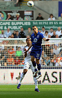 FAO SPORTS PICTURE DESK<br /> Pictured L-R: Ashley Williams of Swansea battling for a header against Leon Osman of Everton. Saturday, 24 March 2012<br /> Re: Premier League football, Swansea City FC v Everton at the Liberty Stadium, south Wales.