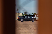 MEXICALI, MEXICO - April 5 A convoy of transport of the President of the United States of America Donald Trump passes in the middle of a strong security device in front of the 9 meter border wall on April 5, 2019 in Mexicali, Mexico.<br /> President Trump on Friday visited Calexico, a small city in a largely agricultural region between Arizona and the Pacific, to inspect an upgraded portion of fencing and to meet with law enforcement. That's more attention than usual for a border town that locals say is defined by its interconnection with Mexico, its infernal summers and its labor-based economy. <br /> (Photo by Luis Boza/VIEWpress)