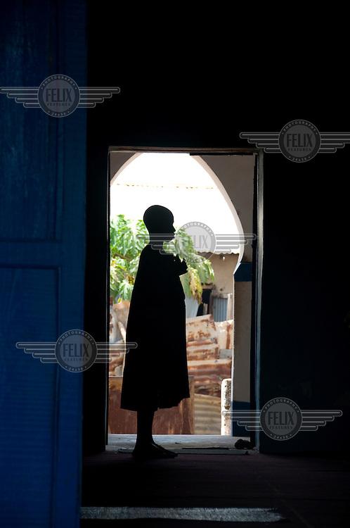 Boy praying in a mosque.