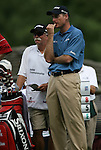 "6 September 2008:   Jim Furyk waits for the his turn to tee off with his caddy, Mike ""Fluff"" Cowan (at left)  in the third round of play at the BMW Golf Champion ship at Bellerive Country Club in Town & Country, Missouri, a suburb of St. Louis, Missouri. Furyk was the leader after the conclusion of round two with a score of 62.  After the first nine holes of the 18-hole third round, Furyk was 11 under-par.  The BMW Championship is the third event of the Fed Ex Cup and the top 30 finishers will qualify for the next event of the championship."