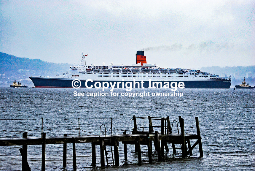 Cunard Liner, Queen Elizabeth 11, sailing up Belfast Lough, N Ireland, on its final tour of the United Kingdom before going to the Middle East where it was going to be converted to a floating hotel. 200810041543..Copyright Image from Victor Patterson, 54 Dorchester Park, Belfast, UK, BT9 6RJ..Tel: +44 28 9066 1296.Mob: +44 7802 353836.Voicemail +44 20 8816 7153.Skype: victorpattersonbelfast.Email: victorpatterson@mac.com.Email: victorpatterson@ireland.com (back-up)..IMPORTANT: If you wish to use this image or any other of my images please go to www.victorpatterson.com and click on the Terms & Conditions. Then contact me by email or phone with the reference number(s) of the image(s) concerned.