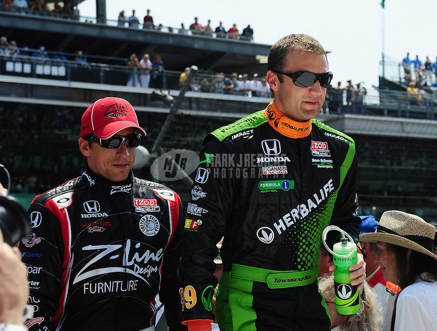 May 30, 2010; Indianapolis, IN, USA; IndyCar Series driver Justin Wilson (left) and Townsend Bell during the Indianapolis 500 at the Indianapolis Motor Speedway. Mandatory Credit: Mark J. Rebilas-