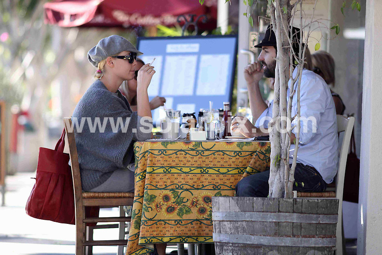 **ALL ROUND EXCLUSIVE PICTURES FROM SOLARPIX.COM**.**WORLDWIDE SYNDICATION RIGHTS**.**NO PUBLICATION IN AUSTRALIA, NEW ZEALAND,.DENMARK, GERMANY OR USA**.Katherine Heigl and her husband Josh Kelly have a smoking breakfast on the patio of Cafe Du Village in Los Angeles, where Katherine enjoys staring off the day by smoking a few cigarettes with breakfast. Los Angeles, California, USA. 12th November 2008..This pic: Katherine Heigl and Josh Kelly..JOB REF: 7869 LAP (MDAS)  DATE: 12_11_2008 .**MUST CREDIT SOLARPIX.COM OR DOUBLE FEE WILL BE CHARGED* *UNDER NO CIRCUMSTANCES IS THIS IMAGE TO BE REPRODUCED FOR ANY ONLINE EDITION WITHOUT PRIOR PERMISSION*