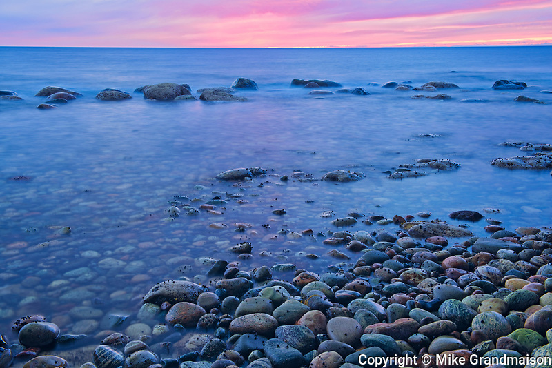 View of rocks along the Gulf of St. Lawrence at dusk. Northern Peninsula. <br />