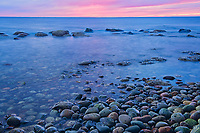 View of rocks along the Gulf of St. Lawrence at dusk. Northern Peninsula. <br />The Arches Provincial Park<br />Newfoundland & Labrador<br />Canada