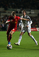 Pictured: Michu of Swansea (R) against Steven Gerrard of Liverpool (L).<br />