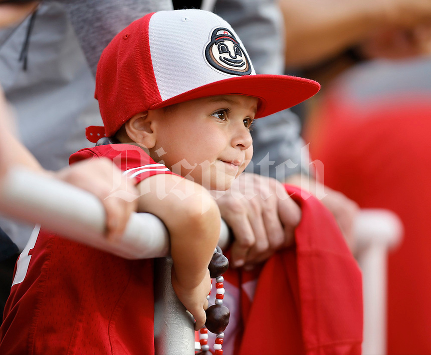 Colton Owens, 5, of Louisville, watches warmups before Thursday's NCAA Division I football game between the Ohio State Buckeyes and the Indiana Hoosiers at Memorial Stadium in Bloomington, Ind., on August 31, 2017. Colton attended the game with his parents Shawn and Victoria Owens. [Barbara J. Perenic/Dispatch]