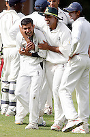 B Thakker (L) is mobbed after dismissing G Arnold during the Middlesex County Cricket League Division Three game between North Middlesex and Harrow at Park Road, Crouch End on Sat Aug 7, 2010.