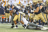 Annapolis, MD - September 8, 2018: Navy Midshipmen quarterback Malcolm Perry (10) is tackled by several Memphis Tigers defenders during the game between Memphis and Navy at  Navy-Marine Corps Memorial Stadium in Annapolis, MD.   (Photo by Elliott Brown/Media Images International)