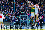 Padraig McNulty Tyrone punches the ball from David Moran Kerry  during their National League clash in Fitzgerald Stadium on Sunday