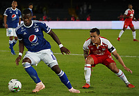 BOGOTÁ - COLOMBIA, 15-01-2019: Felipe Roman (Der) Jugador de Millonarios, disputa balon con Luis M. Sejias (Izq) jugador del Independiente Santa Fe, durante partido entre Independiente Santa Fe y Millonarios, por el Torneo Fox Sports 2019, jugado en el estadio Nemesio Camacho El Campin de la ciudad de Bogotá. / Felipe Roman (R) player of Millonarios vies for the ball with Luis M. Sejias (L) Player of Independiente Santa Fe during a match between Independiente Santa Fe and Millonarios, for the Fox Sports Tournament 2019, played at the Nemesio Camacho El Campin stadium in the city of Bogota. Photo: VizzorImage / Diego Cuevas / Cont