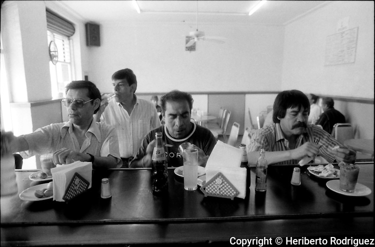 Archive photo of Mexican boxer Ruben Olivares, best known as El Puas, eating at the Mexico Citys' canteen Las Delicias, along with three friends, June 19, 1992..  © Photo by Heriberto Rodriguez