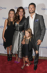 BEVERLY HILLS, CA - SEPTEMBER 28: Neriah Shae Fisher, Brooke Burke-Charvet, David Charvet and Rain Charvet attend Operation Smile's 30th Anniversary Smile Gala - Arrivals at The Beverly Hilton Hotel on September 28, 2012 in Beverly Hills, California.