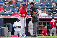 Buffalo Bisons manager Bobby Meacham (12) argues a call with home plate umpire Jeremy Riggs during the game against the Durham Bulls at Durham Bulls Athletic Park on April 30, 2017 in Durham, North Carolina.  The Bisons defeated the Bulls 6-1.  (Brian Westerholt/Four Seam Images)